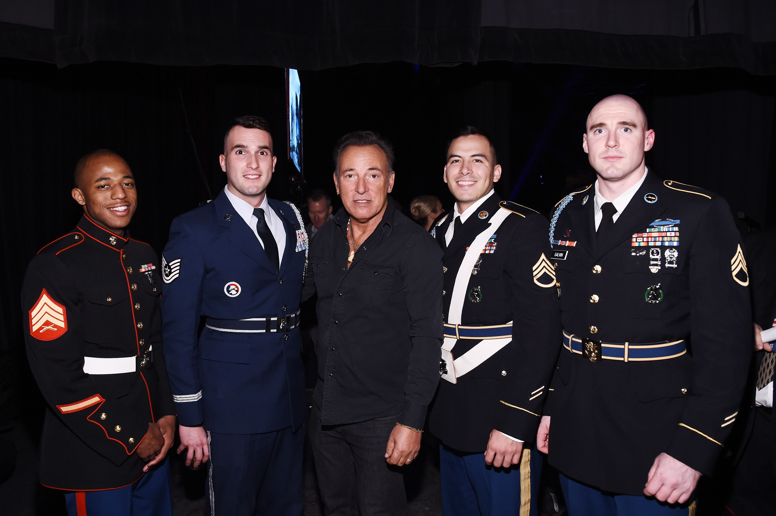 NEW YORK, NY - NOVEMBER 10: Musician Bruce Springsteen poses with soldiers backstage at the New York Comedy Festival and the Bob Woodruff Foundation's 9th Annual Stand Up For Heroes Event on November 10, 2015 in New York City. (Photo by Ilya S. Savenok/Getty Images for Academy of Motion Picture Arts and Science)